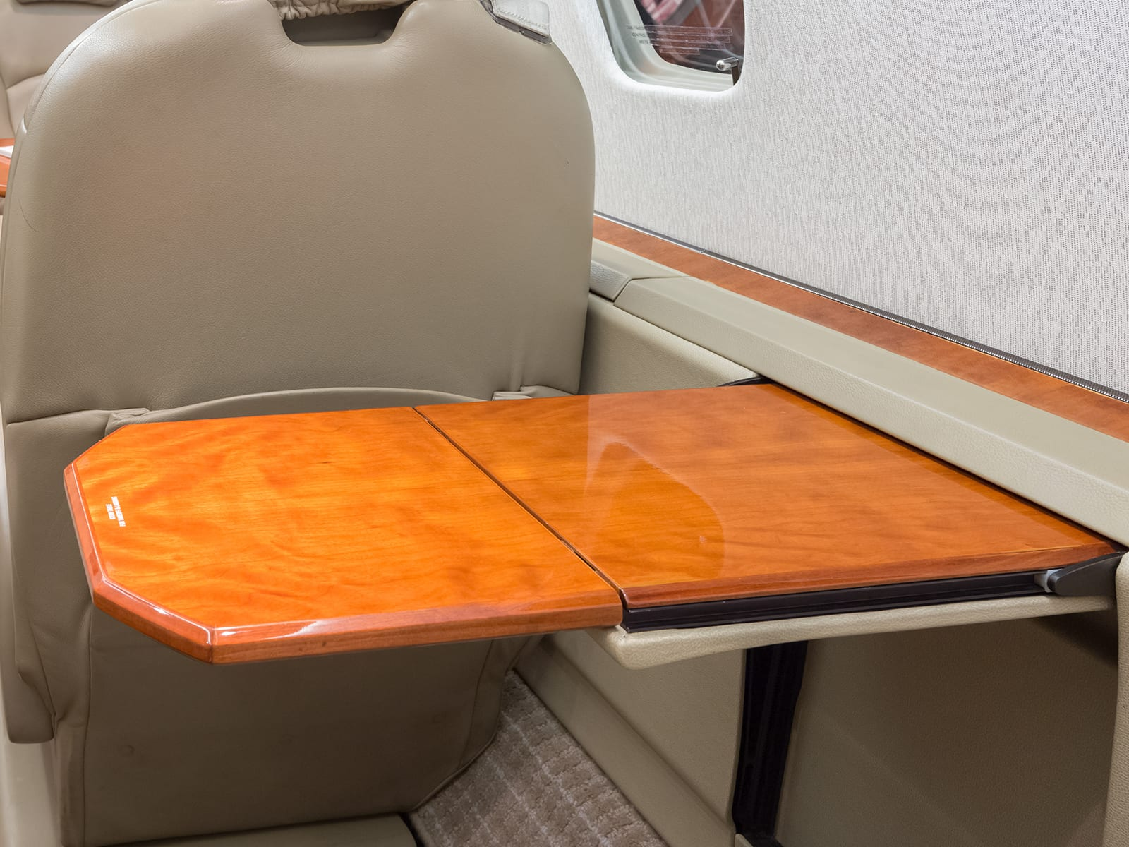 A fold out table in a Priority Jet aircraft