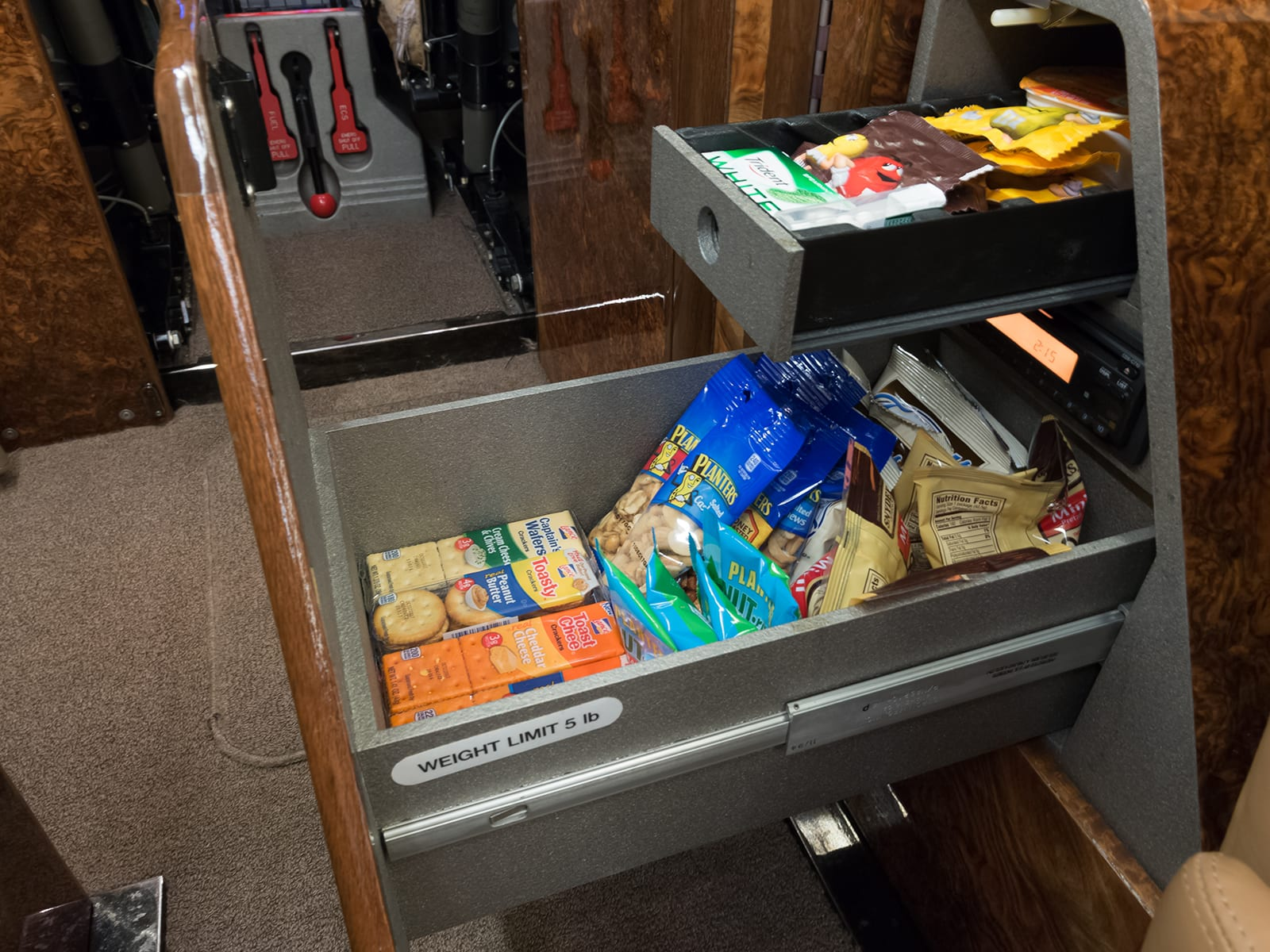 A snack drawer on a Priority Jet Aircraft