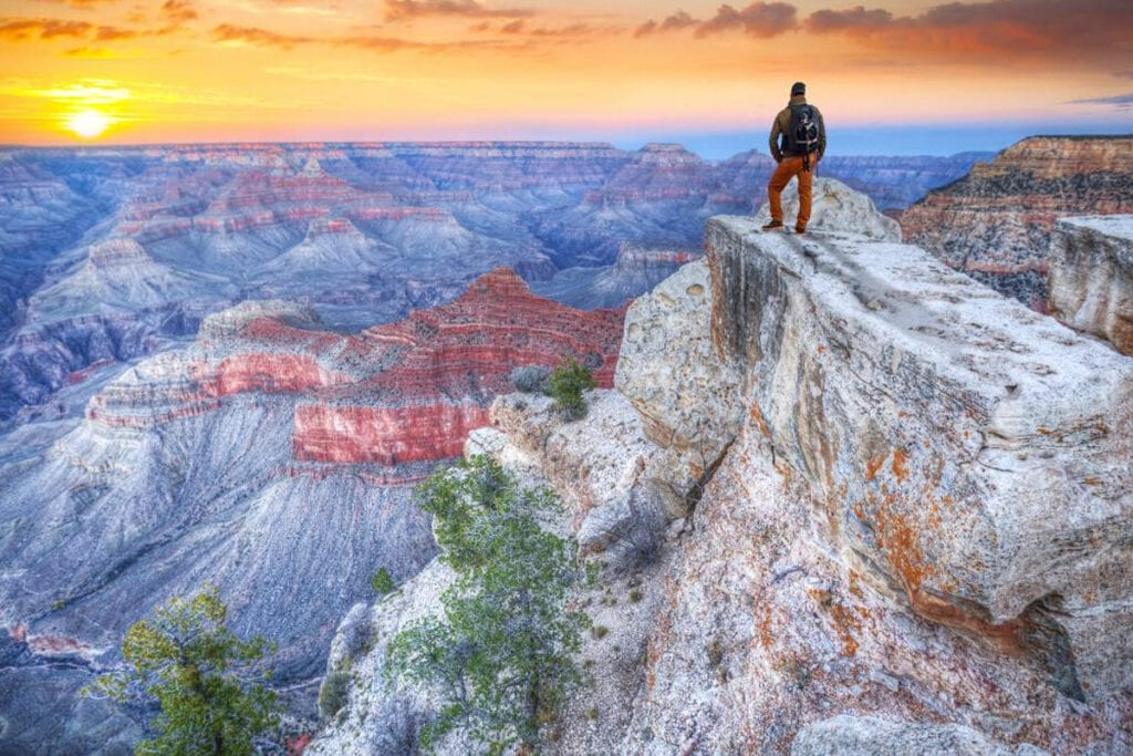 picture of man overlook the grand canyon